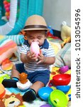 thai boy 7 months old is... | Shutterstock . vector #1013054596