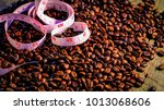 coffee beans and yellow... | Shutterstock . vector #1013068606