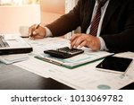 a businessman analyzing... | Shutterstock . vector #1013069782