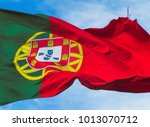 portugal waving flag in blue sky | Shutterstock . vector #1013070712