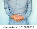 businessman holding his stomach ... | Shutterstock . vector #1013078716