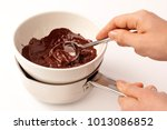 woman melting chocolate in a... | Shutterstock . vector #1013086852