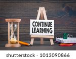 Small photo of Continue learning. Sandglass, hourglass or egg timer on wooden table showing the last second or last minute or time out