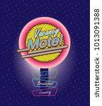 motel sign illuminated at night ... | Shutterstock .eps vector #1013091388