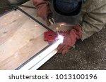the welder cooks the frame. the ... | Shutterstock . vector #1013100196