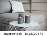 burning candles on table indoors | Shutterstock . vector #1013107672