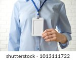 woman with blank badge  closeup.... | Shutterstock . vector #1013111722