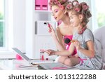 mother with cute daughter doing ... | Shutterstock . vector #1013122288