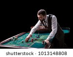 croupier behind gambling table... | Shutterstock . vector #1013148808