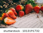 Small photo of vintage background with aphrodisiac fruits and powder sugar with white space for text, message or quotes, valentine day background with space for sweet messages