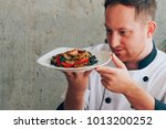 chef man looking at spaghetti... | Shutterstock . vector #1013200252