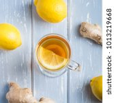 a cup of ginger tea with lemon... | Shutterstock . vector #1013219668