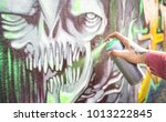 street artist painting colorful ... | Shutterstock . vector #1013222845