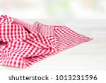 the checkered tablecloth on a...   Shutterstock . vector #1013231596