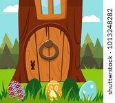 easter bunny door in a tree... | Shutterstock .eps vector #1013248282