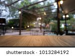 image of wooden table in front... | Shutterstock . vector #1013284192