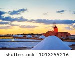 sunset at windmill in the salt... | Shutterstock . vector #1013299216