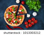 homemade pizza with tomatoes ...   Shutterstock . vector #1013303212
