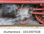 steam locomotive at the exit... | Shutterstock . vector #1013307028