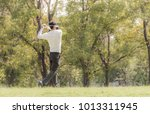 male golfers are playing which... | Shutterstock . vector #1013311945