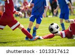 a group of young soccer players ... | Shutterstock . vector #1013317612