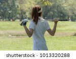 Women\'s Golf Using Golf Clubs...