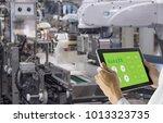 industry 4.0 robot concept ... | Shutterstock . vector #1013323735