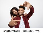 happy young african american... | Shutterstock . vector #1013328796
