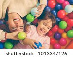 top view of cheerful mother and ... | Shutterstock . vector #1013347126