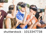 group of friends playing on vr... | Shutterstock . vector #1013347738
