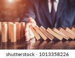 business man placing wooden... | Shutterstock . vector #1013358226