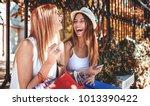 shopping time. two beautiful... | Shutterstock . vector #1013390422