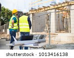 workers in hardhat and green... | Shutterstock . vector #1013416138