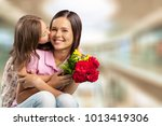 mom and daughter are kissing | Shutterstock . vector #1013419306