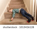 a young caucasian toddler boy... | Shutterstock . vector #1013426128