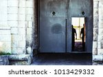 entrance gate to prison with... | Shutterstock . vector #1013429332