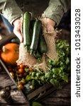 organic vegetables on wood.... | Shutterstock . vector #1013433028