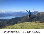 happy hiker is jumping in the... | Shutterstock . vector #1013448232