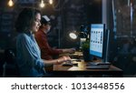 beautiful female coder works at ... | Shutterstock . vector #1013448556