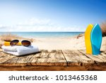 summer desk space  | Shutterstock . vector #1013465368