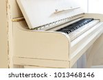white piano  side view of... | Shutterstock . vector #1013468146