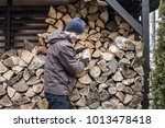 Caucasian Man Taking Firewood...