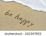 Be Happy Handwritten In Sand...