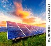 solar panel on beautiful orange ... | Shutterstock . vector #1013518915