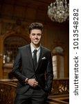handsome guy wearing expensive... | Shutterstock . vector #1013548282