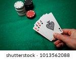 senior poker. four playing... | Shutterstock . vector #1013562088