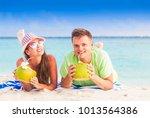 happy young couple having fun... | Shutterstock . vector #1013564386