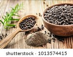 black pepper in bow on wooden... | Shutterstock . vector #1013574415