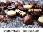 a lot of variety chocolate... | Shutterstock . vector #1013585605