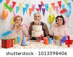 seniors celebrating a birthday... | Shutterstock . vector #1013598406